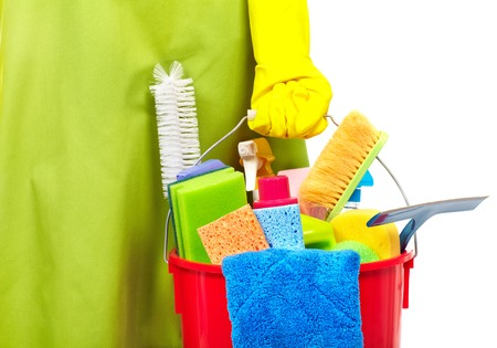 Maid hands with cleaning tools. House cleaning service concept. Standard-Bild