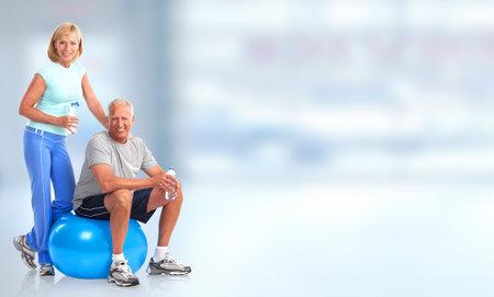 Senior healthy fitness couple. Over blue background Stockfoto