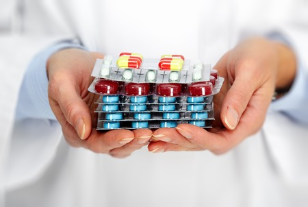 Doctor hands with pills. Health care concept.