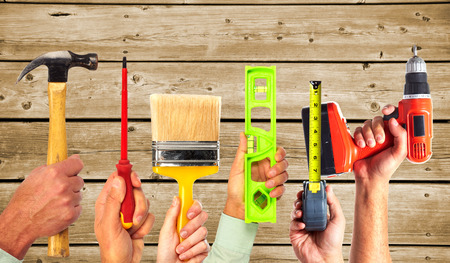 Hands of handyman with tools. House renovation and construction. Stock Photo