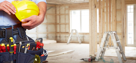 Builder handyman with construction tools. House renovation background. Reklamní fotografie - 48411672