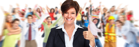Beautiful mature business woman over people group background. Stock Photo