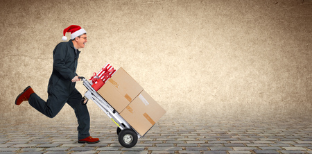 Delivery man with boxes. Express Christmas shipping. Stock Photo