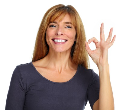 Beautiful happy woman isolated over white background.