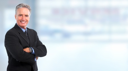 Smiling mature  businessman over blue background