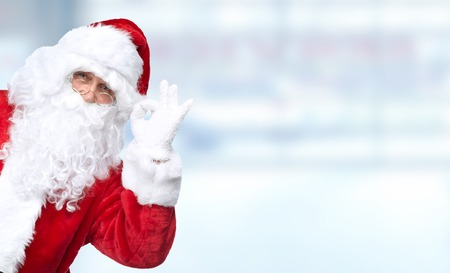 Christmas Santa Claus portrait over blue  background Stock Photo