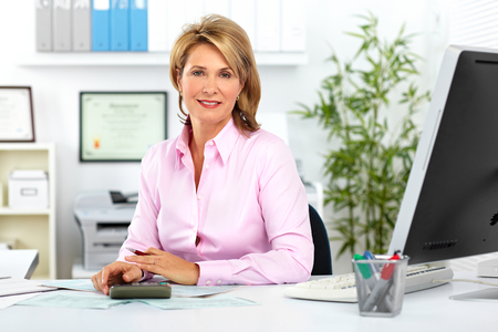 Mature business woman working with computer in the office. Stok Fotoğraf - 49253979