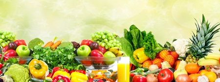 Fresh Vegetables and fruits over green background. Healthy diet. Stock Photo