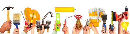 Hands of handyman with tools. House renovation and construction. Banque d'images