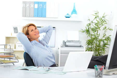Beautiful mature business woman relaxing in modern office. Stock Photo - 49607282