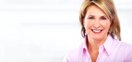 Beautiful mature business woman working in modern office. Banco de Imagens