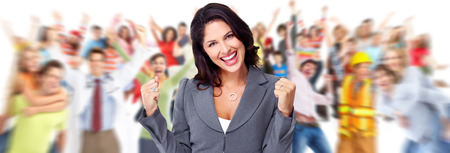 Happy young business woman over people group background. Stock Photo