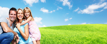 Happy family with kids over green landscape background.
