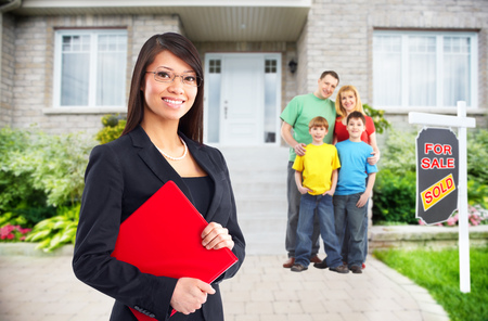 Real Estate agent woman near new house. Home for sale concept.