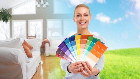 Woman with painting colors. House renovation background.
