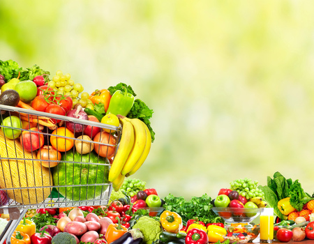 Grocery shopping cart with fruits and vegetables. Stock Photo