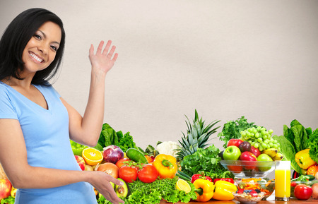 Beautiful asian woman with vegetables and fruits.