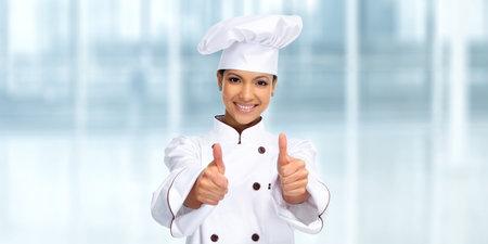 Lachend Aziatische chef-kok vrouw. Voeding en dieet concept.