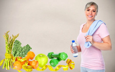 Senior woman with bottle of water. Dieting and sport background.