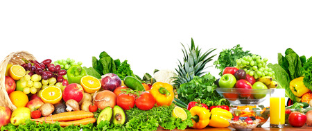 Fresh fruits and vegetables over white background.