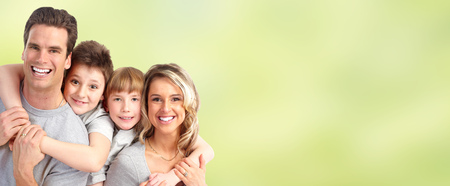 Happy family with kids over green abstract background. Stock Photo