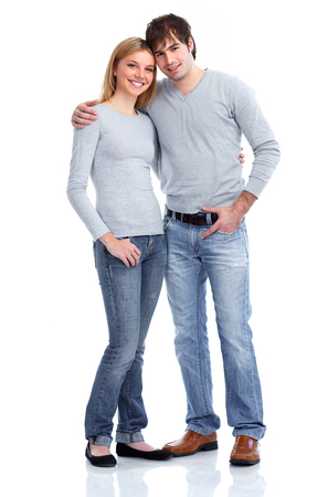 Young students couple isolated over white background.