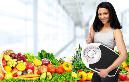 Beautiful asian woman with scales and fruits. Stock Photo