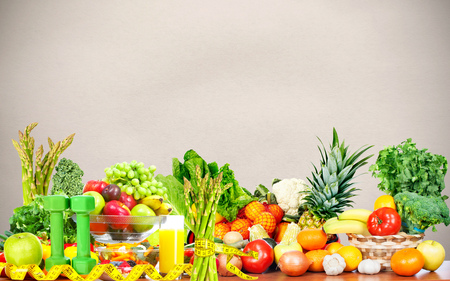 Vegetables fruits and dumbbells . Dieting and sport background. Stock Photo