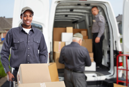 African american Delivery man. Express post service. Stock Photo