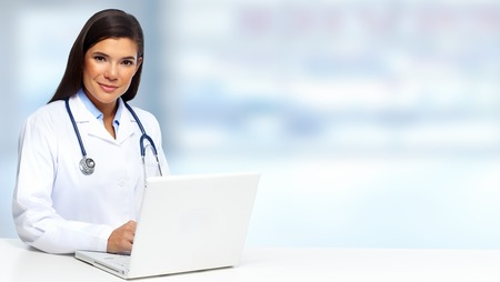 Young Doctor woman working with laptop computer.