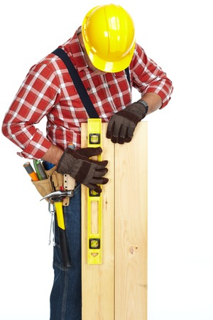 Hands of worker with wooden plank and ruler over white background.