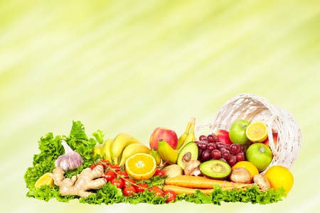 Vegetables and fruits on abstract green background. Stock Photo