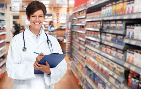 Mature medical doctor woman over pharmacy background.
