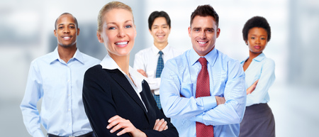 Beautiful young business woman over workers team background.