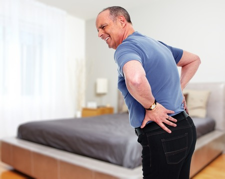 Senior man with a lower back pain. Health problem concept.