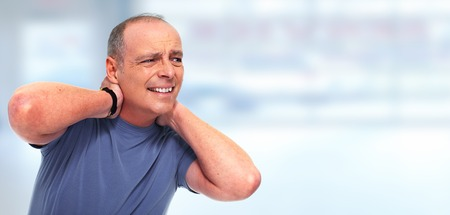 Senior man with a neck pain and migraine. Health problem concept.