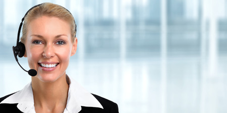 Smiling young agent business woman with headsets.