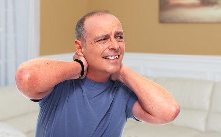 Senior man with a neck pain and migraine. Health problem concept. Reklamní fotografie
