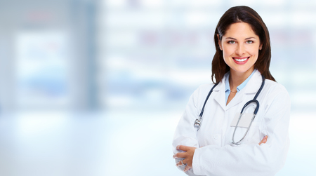 Medical doctor woman on abstract blue background. Stock Photo