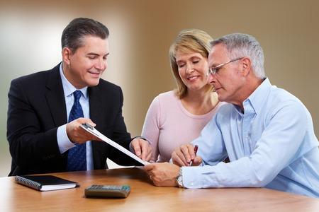 Senior couple talking with insurance agent. Retirement. Stock fotó