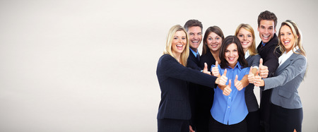 Group of happy business people over gray background. Stock Photo
