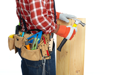 Builder handyman with construction tools on white background.