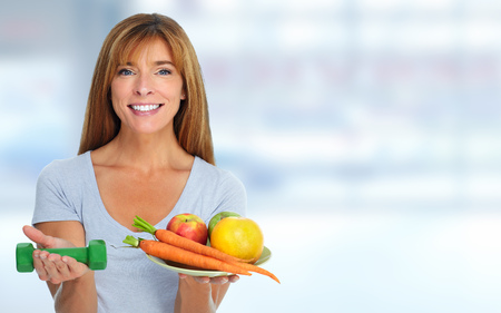 Woman with vegetables and fruits. Dieting and sport background.