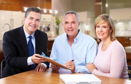 Senior couple talking with insurance agent. Retirement. Imagens