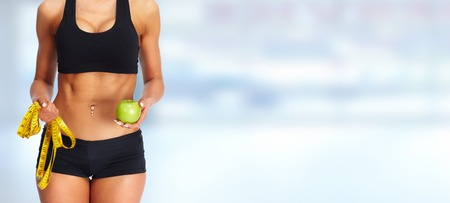 Woman abdomen with measuring tape. Weight loss and dieting. Stock Photo