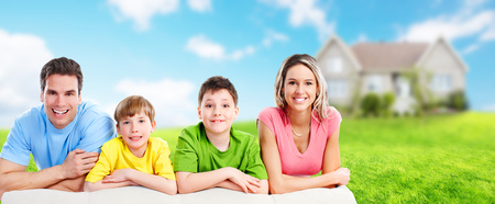 Happy family with kids over new house background.