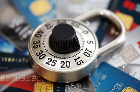 Combination lock with credit card. Protection and security concept.