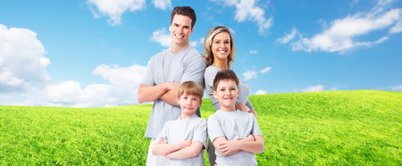 Happy family with kids over landscape background.