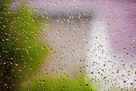 Raindrops on the window glass. Rain background.