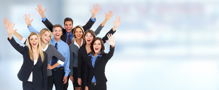 Group of happy business people over blue background. Foto de archivo